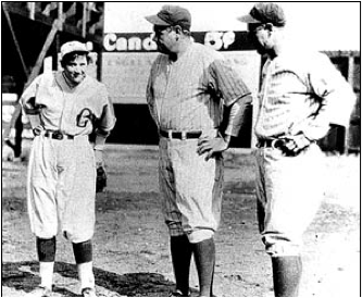 Mitchell with Babe Ruth and Lou Gehrig after the game where she struck them both out.